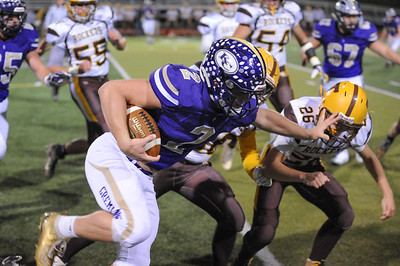 Karns City #2 Anthony Kamenski  runs a quarterback keeper as Titusville #26 Jaydin Blake goes for the tackle during a game at Karns City Stadium on Friday October 25, 2019 (Jason Swanson photo)