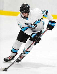 Harold Aughton/Butler Eagle: Seneca Valley Ryan Russell brings to puck down the ice in the second period. Seneca Valley out lasted Butler winning 4-3 in the third period.