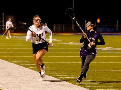 Mars' Mara Fuller (12)  pushes down field against Plum's Megan Franzi (9). Seb Foltz/Butler Eagle