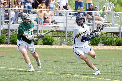 Mars' Mike Doye winds up to fire a shot on goal in the Planets' playoff win over Trinity. Seb Foltz/Butler Eagle