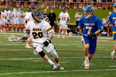 Nick Spotti (20) of Mars works around Hampton's Michael Manganaro (7). Seb Foltz/Butler Eagle