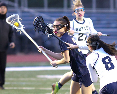Mars'Charlotte Stamper takes a shot on goal Friday's, 15-2 Mars win at Butler. Seb Foltz/Butler Eagle 03/26/21