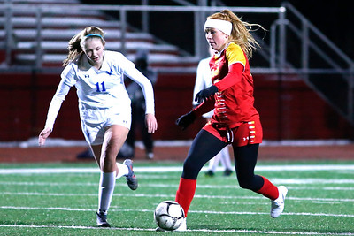 North Catholic's Tori Michalski (13) pushes past Villa Maria's Abby Godlewski in the second half of the Trojans 4-2 state semifinal loss to the Victors. Seb Foltz/Butler Eagle
