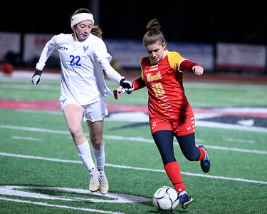 North Catholic's Maddie Laird fights off a challenge from Villa Maria's Moira Thunell in the second half of the Trojans 4-2 loss to the Victors. Seb Foltz/Butler Eagle