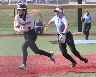 Seneca Valley shortstop Mackenzie Baker fields a ball and turns to throw North Allegheny's Rachel Rusnica out at third. Seneca fell to NA 6-2 at home. Seb Foltz/Butler Eagle