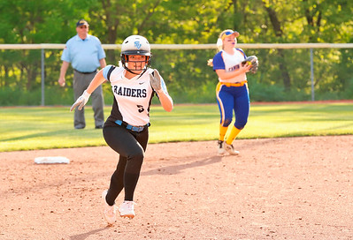 Mackenzie Baker heads to third in Seneca's playoff game against Canon Mac. Seb Foltz Butler/Eagle