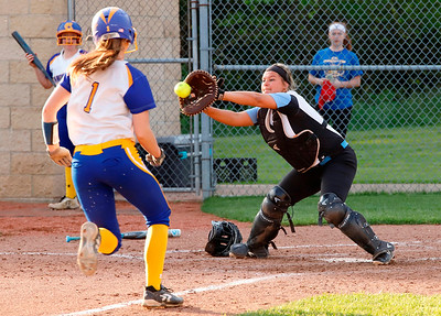 Senea catcher Karli Hacker (#6)  catches a runner to make a play at home. Seb Foltz/Butler Eagle