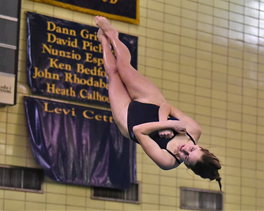 Butler's Paige Williams rotates through a backflip one and a half twist in Wednesday night's meet against North Allegheny. Seb Foltz/Butler Eagle