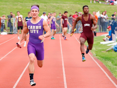 Karn City's Hunter Jones pushes down the stretch to anchor the 4x100 meter. Seb Foltz/Butler Eagle
