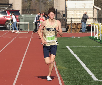 Butler's C.J. Singleton leads the pack in the 3,200 meter run during Friday's Butler Track and Field Invitational. Seb Foltz/Butler Eagle 04/23/21