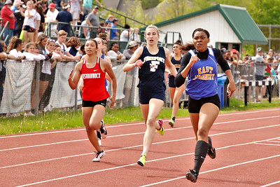AA 400 Meter:  C-Keiyah Marshall finished first (right) Sidney Shemanski of Freeport third (center), Neleh Nogay of Neshannock fourth (left). Seb Foltz/ Butler Eagle.