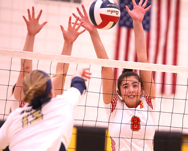 North Catholic's Ava Whitesel (8) goes for a block against Freeport's Tori Radvan during the Trojans 2-0 State semi final win Tuesday. Seb Foltz/Butler Eagle