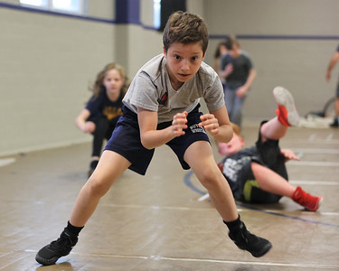 Nick Savannah comes out of a roll in the ready position during a drill at Legacy Wrestling Practice in Butler Tuesday. Seb Foltz/Butler Eagle 05/05/21