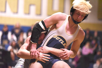 Butler's Nate McDonald attempts an escape from Knoch's Kyle Lauster. McDonald broke an overtime tie to win the match. Seb Foltz/Butler Eagle