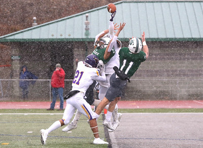 Minnesota State's Cheyenne Bradford Jr. (11)  breaks up a pass to Slippery Rock recievers Henry Litwin(11) and Qaadir Dixon (80). Cade Johnson (21) assists on the coverage. Seb Foltz/Butler Eagle