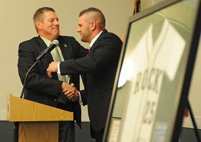 Director of Athletics Paul Lueken, left, congratulates St. Louis Cardinals first baseman and former SRU great Matt Adams after his number retirement ceremony at Slippery Rock University's Russell Wright Alumni House on Saturday, February 7, 2015.  (Tye Cypher for the Butler Eagle)