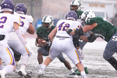 The hole closes for Slippery Rock runningback Charles Snorweah in Saturday's game against Minnesota State. SRU showed flashes but failed to get their offense running, falling to Minnesota State 58-8. Seb Foltz/Butler Eagle