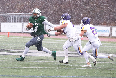 Slippery Rock quarterback Roland Rivers III attempts to evade Minnesota State Defenders during Saturday's playoff game at home. Defensive pressure all game caused the SRU offense to struggle in the 58-8 loss. Seb Foltz/Butler Eagle