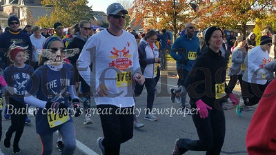Jim Smith photoRunners take off Saturday morning in the 38th Annual Butler YMCA Turkey Trot in Butler. The event — a 5K race and a one-mile kids run — attracted about 350 runners despite freezing temperatures. 3 col .pic