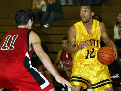 Butte College's #12 Brian Smith looks to pass around Foothill College's #11 Kevin Ochoa with about 15:00 to go during the first half of thier basketball game Saturday. - halley photo 1/7/05