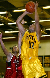 Butte College's #12 Brian Smith puts up a shot over College of Holy Names' #44 Justin Lee (not seen) and #14 Wes Lee putting Butte ahead 48-28 with 1:30 to go in the first half of their basketball game Wednesday night - halley photo 11/16/05
