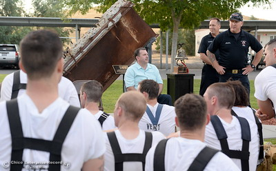 Tom Cole, Mike Murphy and Erik Rapp left to right, speak to members of the 68th Butte College Fire Academy after they climbed 110 floors of stairs to replicate the flights of stairs that fallen firefighters took on Sept. 11, 2001. Each cadet researched a fallen firefighter and wears a photo of that firefighter on their helmet during the memorial tribute Wed. Sept. 13, 2017.  (Bill Husa -- Enterprise-Record)