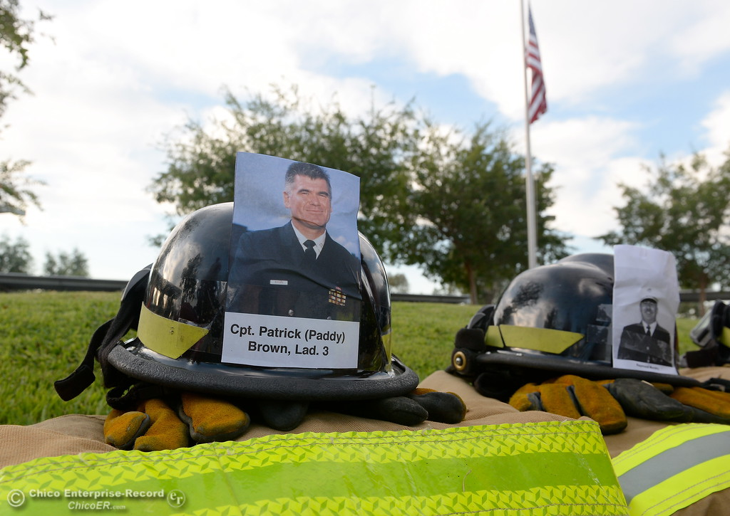 . Members of the 68th Butte College Fire Academy carry hoses and tools as they climb 110 floors of stairs to replicate the flights of stairs that fallen firefighters took on Sept. 11, 2001. Each cadet researched a fallen firefighter and wears a photo of that firefighter on their helmet during the memorial tribute Wed. Sept. 13, 2017.  (Bill Husa -- Enterprise-Record)