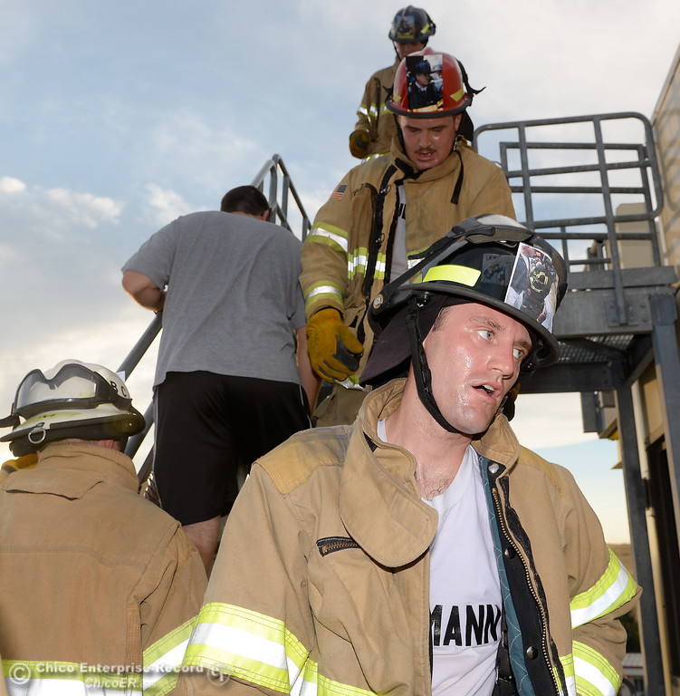 . Mathew Seligmann breaks a sweat along with other members of the 68th Butte College Fire Academy as they carry hoses and tools as they climb 110 floors of stairs to replicate the flights of stairs that fallen firefighters took on Sept. 11, 2001. Each cadet researched a fallen firefighter and wears a photo of that firefighter on their helmet during the memorial tribute Wed. Sept. 13, 2017.  (Bill Husa -- Enterprise-Record)