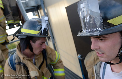 Members of the 68th Butte College Fire Academy carry hoses and tools as they climb 110 floors of stairs to replicate the flights of stairs that fallen firefighters took on Sept. 11, 2001. Each cadet researched a fallen firefighter and wears a photo of that firefighter on their helmet during the memorial tribute Wed. Sept. 13, 2017.  (Bill Husa -- Enterprise-Record)