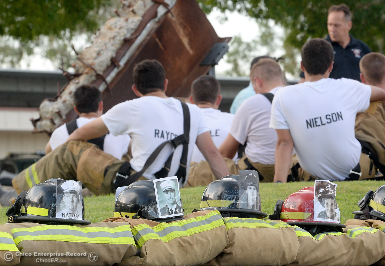 Members of the 68th Butte College Fire Academy rest and listen to speakers after they climbed 110 floors of stairs to replicate the flights of stairs that fallen firefighters took on Sept. 11, 2001. Each cadet researched a fallen firefighter and wears a photo of that firefighter on their helmet during the memorial tribute Wed. Sept. 13, 2017.  (Bill Husa -- Enterprise-Record)
