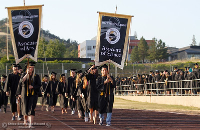 The soon to be graduates of the Butte College Associates of Science and Arts walk onto the football field to begin the commencement ceremony for the Butte College Class of 2016 May 27, 2016 at Butte College in Oroville, Calif. (Emily Bertolino -- Enterprise-Record)