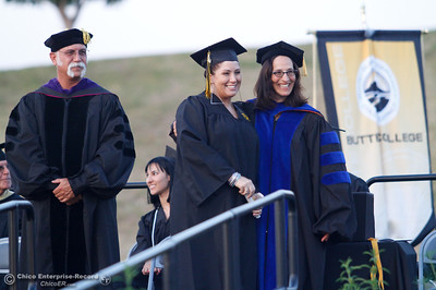 Butte College President Dr. Samia Yaqub poses for a picture with a recent graduate during the commencement ceremony for the Butte College Class of 2016 May 27, 2016 at Butte College in Oroville, Calif. (Emily Bertolino -- Enterprise-Record)