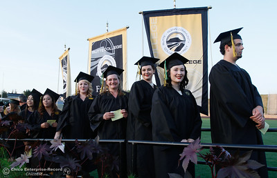 A group of Butte College students line up to receive their diploma during the commencement ceremony for the Butte College Class of 2016 May 27, 2016 at Butte College in Oroville, Calif. (Emily Bertolino -- Enterprise-Record)