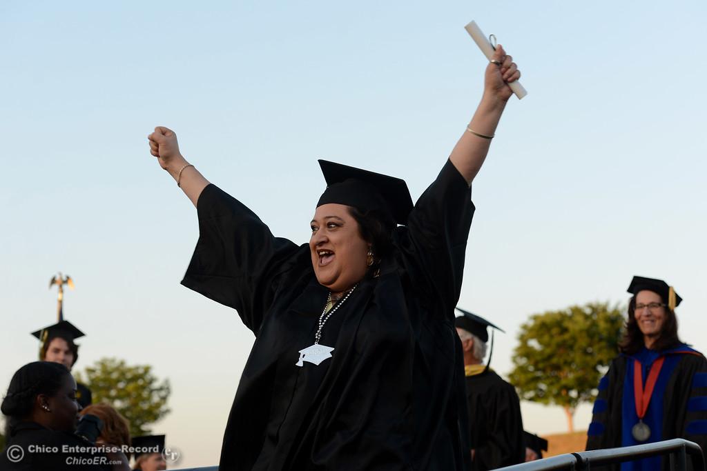 . Dena Molina celebrates as Butte College students graduate Friday, May 26, 2017, at Cowan Stadium in Butte Valley, California.  (Dan Reidel -- Enterprise-Record)