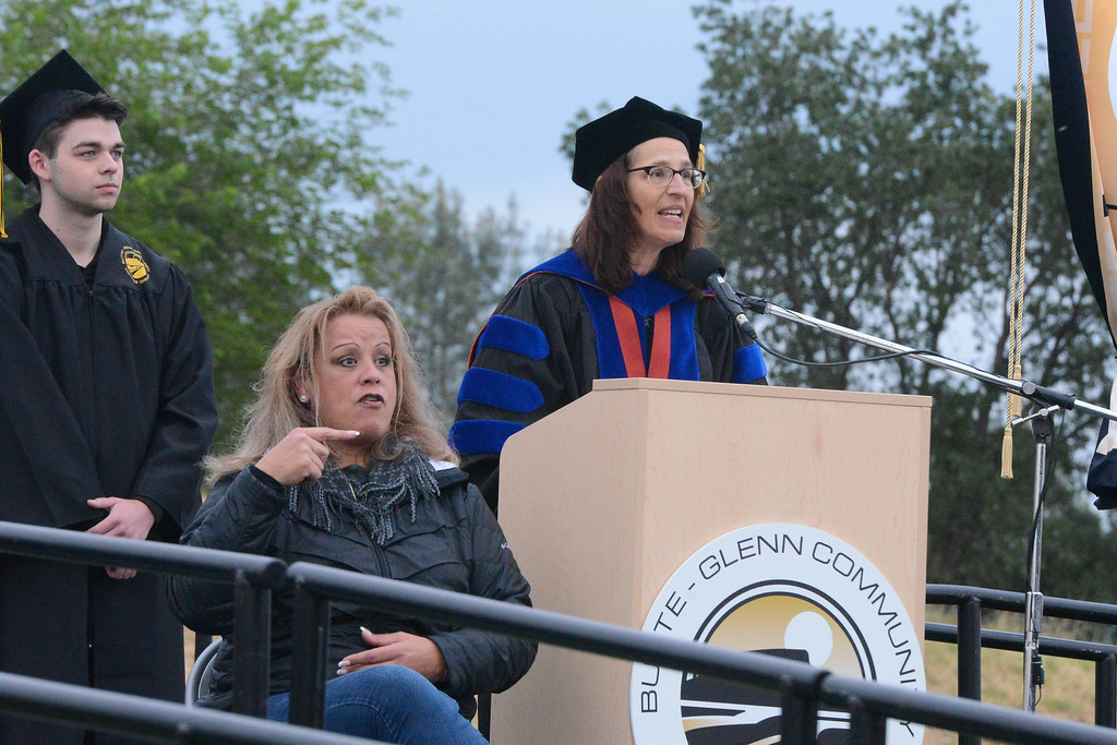 . President Samia Yacqub speaks, while Sharon Houghton interprets at the Butte College Graduation, May 25, 2018,  in Chico, California. (Carin Dorghalli -- Enterprise-Record)