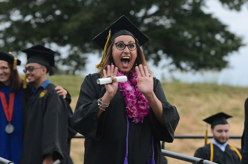 Chels Collier excitedly waves at the crowd during the Butte College Graduation, May 25, 2018,  in Chico, California. (Carin Dorghalli -- Enterprise-Record)