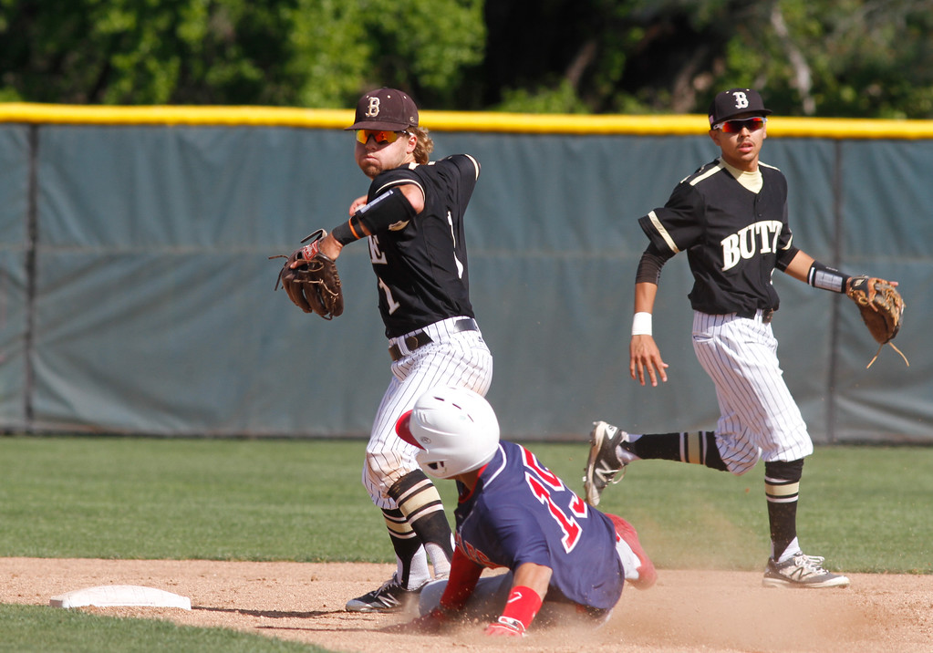 . Butte College\'s Michael Schuler (1) throws to first to complete the 6-4-3 double play during a baseball game against Siskiyous Monday April 10, 2017 at Butte College in Oroville, California. (Emily Bertolino -- Enterprise-Record)