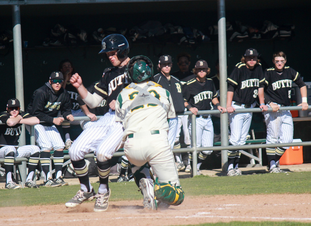 . Butte College\'s Noah Ferguson makes it home off a hit by Eric Robles as Napa Valley College\'s catcher Matt Miles tries to stop him bringing the score to 7-2 Butte during a baseball game Monday February 27, 2017 at Butte College in Oroville, California. Butte went on to sweep Napa 7-4 in game one of a double header. (Emily Bertolino -- Enterprise-Record)