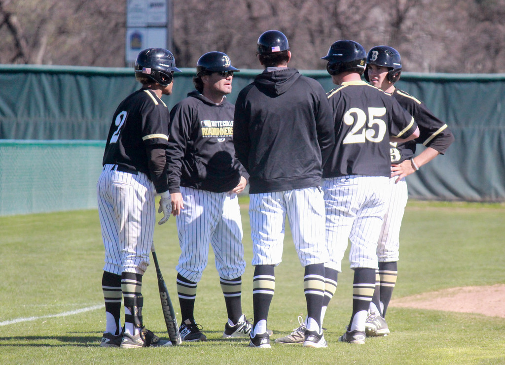 . Butte College head baseball coach Anthony Ferro talks with his infielders during a break against Napa Valley College Monday February 27, 2017 at Butte College in Oroville, California. (Emily Bertolino -- Enterprise-Record)