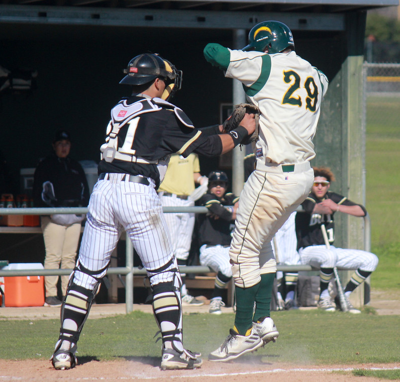 . Butte College\'s catcher RJ Valdez tags out Napa Valley College\'s 	Warren Brusstar during a baseball game Monday February 27, 2017 at Butte College in Oroville, California. (Emily Bertolino -- Enterprise-Record)  Napa Valley College at Butte College men\'s baseball Monday February 27, 2017 at Butte College in Oroville, California. (Emily Bertolino -- Enterprise-Record)