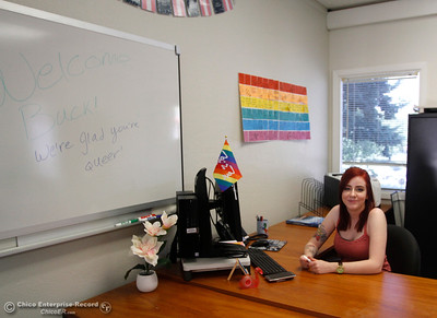 Skylar Darrow, student assistant and founder of the Queer Resource Center, smiles from behind a desk in the QRC which opened for the first time on the first day of school Monday, Aug. 20, 2018, at Butte College in Butte Valley, California. (Dan Reidel -- Enterprise-Record)