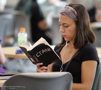A student reads an actual book on the first day of school Monday, Aug. 20, 2018, at Butte College in Butte Valley, California. Every other student was using their phone or computer to do course work. (Dan Reidel -- Enterprise-Record)