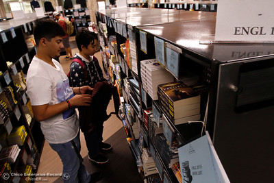 Pedro Alcantar, left, and Andrew Thao peruse the English section of the student bookstore on the first day of school Monday, Aug. 20, 2018, at Butte College in Butte Valley, California. (Dan Reidel -- Enterprise-Record)