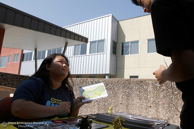 Student life events specialist Audrey Thao, left, points out a location on a map to a student as the first day of school starts Monday, Aug. 20, 2018, at Butte College in Butte Valley, California. (Dan Reidel -- Enterprise-Record)