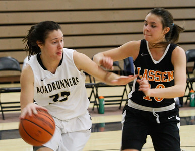 Butte College's Abby Manley drives towards the basket as Lassen's Hailee Simpson tries to stop her during women's basketball game February 15, 2017 at Butte College in Oroville, California. (Emily Bertolino -- Enterprise-Record)