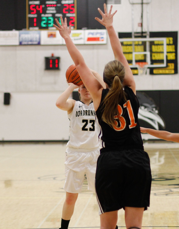 . Butte College\'s Erica Stevenson goes up for shot as Lassen\'s Haley Crowson tries to block her shot during women\'s basketball game February 15, 2017 at Butte College in Oroville, California. (Emily Bertolino -- Enterprise-Record)