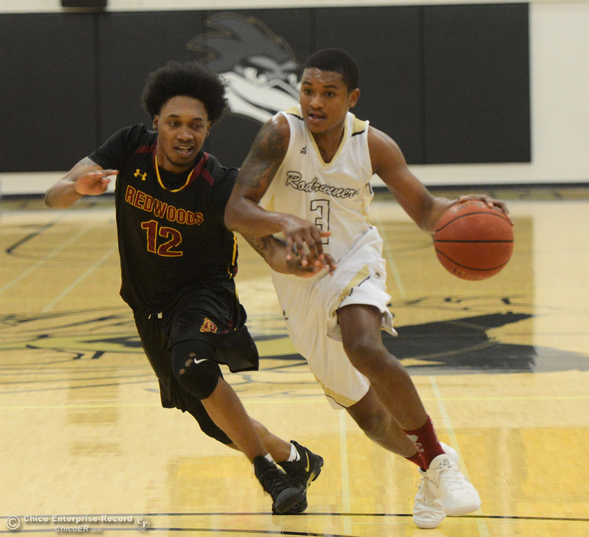 . Butte College\'s Darrien Manker (3) dribbles as Redwoods\' Kameron Lowe (12) tries to steal the ball Thursday January 11, 2018 in Butte Valley, California. (Emily Bertolino -- Enterprise-Record)