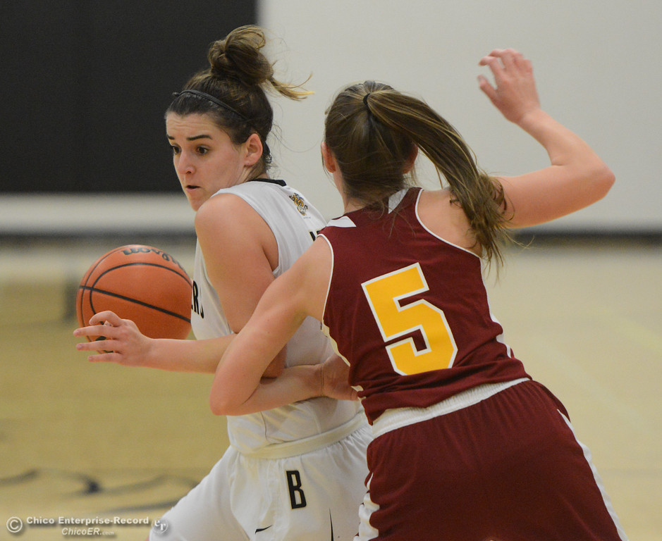 . Butte College\'s Morgan Mason (13) dribbles around Redwoods\' defense Thursday January 11, 2018 in Butte Valley, California. (Emily Bertolino -- Enterprise-Record)