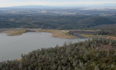 Lake Oroville Dam is seen during a PG&E  flight looking for drought-stricken trees in the Oroville foothills Wednesday, Jan. 25, 2017. (Bill Husa -- Enterprise-Record)