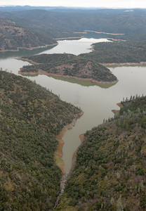 Lake Oroville continues to rise as seen during a PG&E  flight looking for drought-stricken trees in the Oroville foothills Wednesday, Jan. 25, 2017. (Bill Husa -- Enterprise-Record)